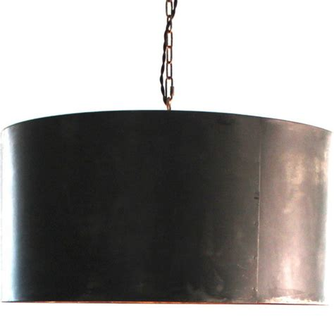 handcrafted drum pendant light with aged zinc or black