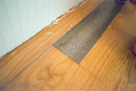 how to lay laminate flooring on floorboards how to install laminate flooring bigger than the three of us