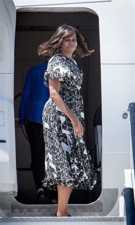 hot  hmm  lady michelle obamas madrid preen