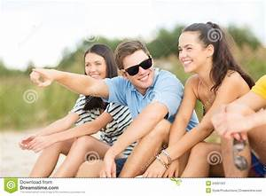 Group Of Friends Pointing Somewhere On The Beach Stock ...