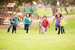 Group Of Young Children Running Towards Camera In Park ...