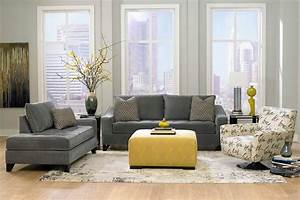 living room dark grey sofas with grey wall paint With living room furniture with yellow walls