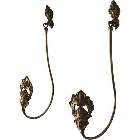 pair of antique gilded bronze drapery curtain tie backs