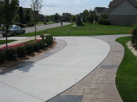 driveway borders cg front blocks edging our solid driveway curving around side to back gate grass and cement