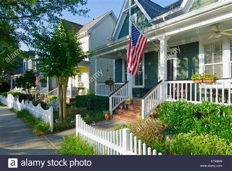 The American Dream Of A Home With A Flag And A White
