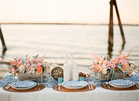 romantic wedding reception table setting on the beach