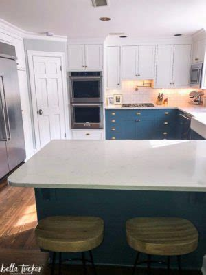 white upper cabinets blue  cabinets bella tucker