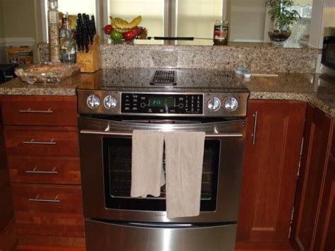 kitchen island with slide in stove slide in range island search kitchens 9453