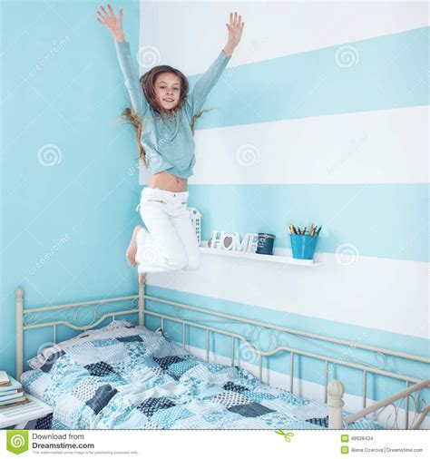Kid Girl Jumping On Bed Stock Photo Image Of Lifestyle