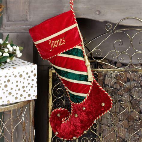 personalised velvet jingle bell christmas stockings by