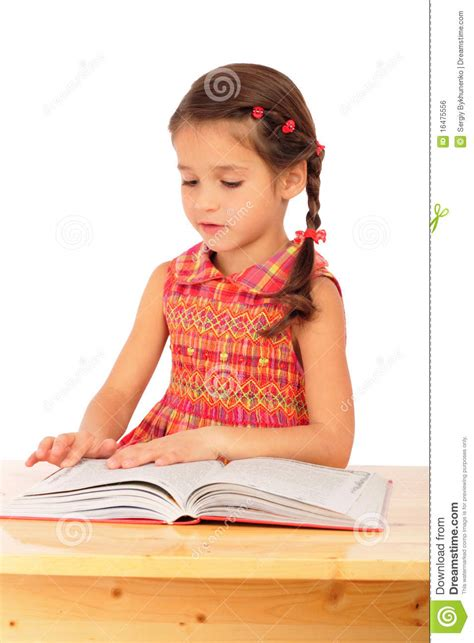 Little Girl Reading Book On The Desk Stock Photo  Image 16475556