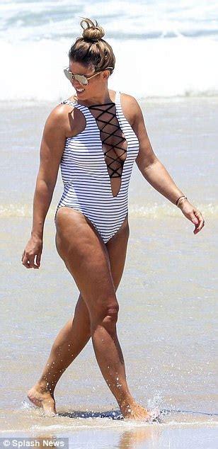 Rebekah Vardy flaunts her assets in swimsuit in Australia ...