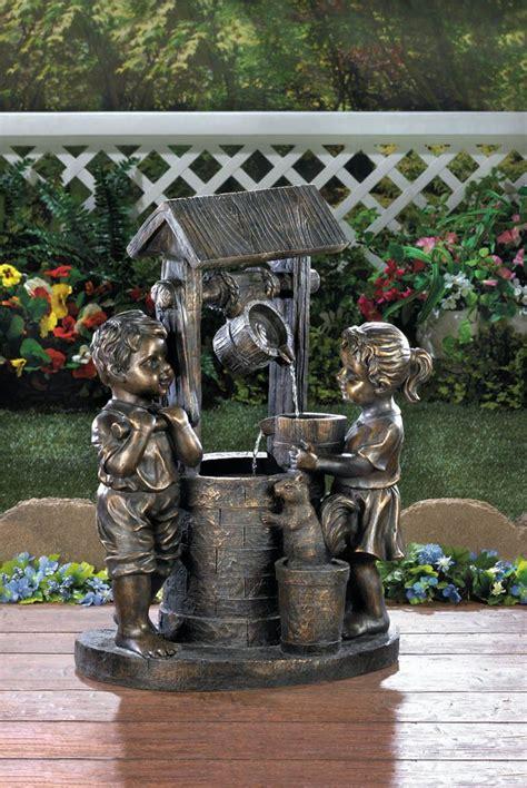jack jill boy girl playing wishing  bronze statue bird