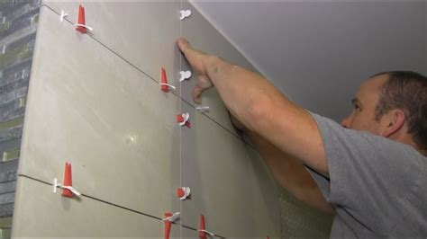 Install Tile In Bathroom by How To Install Large Format Tiles On Bathroom Walls Using