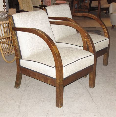 pair of 1930s birch wood armchairs with curved arms