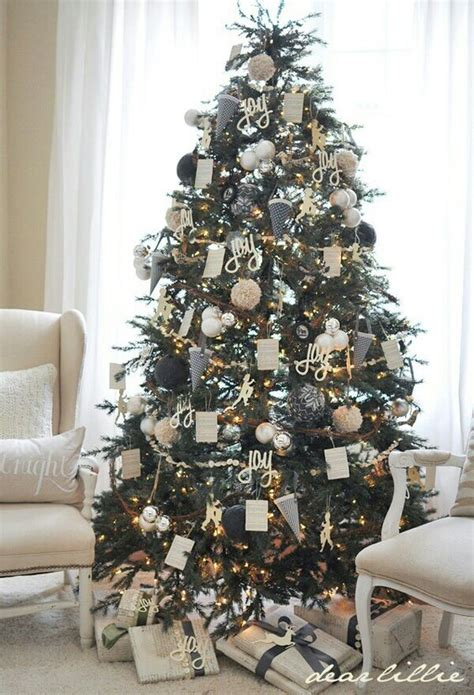 christmas tree decorated whith words 37 awesome silver and white tree decorating