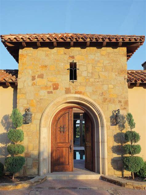 arched front doors  mediterranean house hgtv