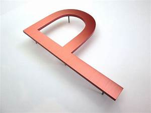 large copper letters metal letters With large metal numbers and letters
