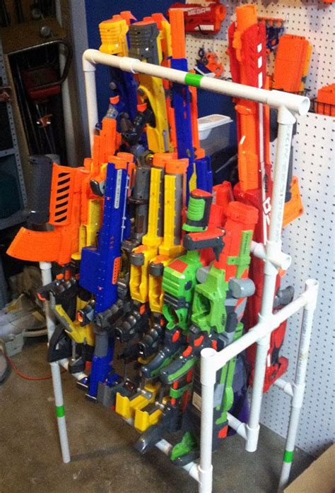 Mount the pegboard to the wall with mounting screws or anchors. Pin on nerf mods