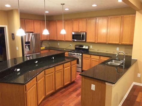rustic kitchen backsplash tile uba tuba granite countertops pictures cost pros cons