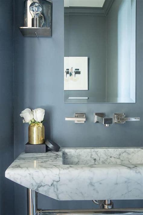 gold  blue powder room boasts slate blue paint  walls