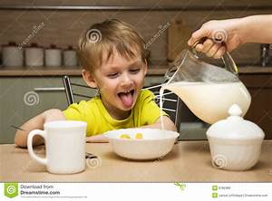 Happy Boy Eating Breakfast Stock Photo - Image: 6782360