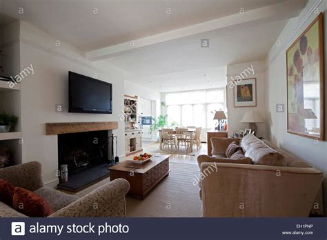 open planned living open plan living room with plasma screen above fireplace in stock photo royalty free image