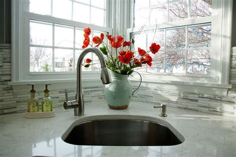 kitchen faucet placement the placement of the faucet in this corner sink makes it