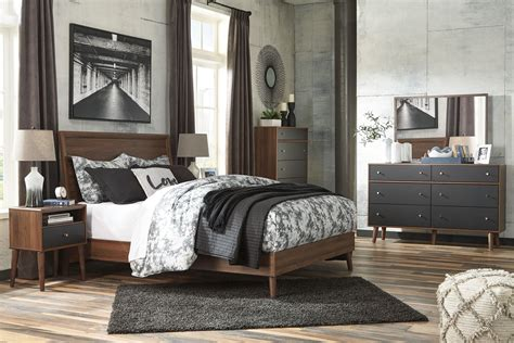 Daneston Brown And Black Panel Bedroom Set From Ashley