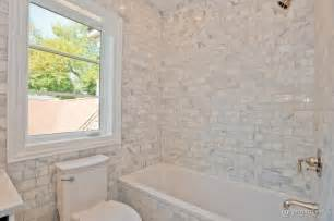 calcutta gold marble subway tile transitional bathroom