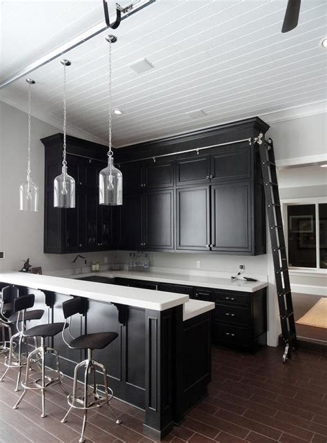 Man Cave With Black And White Wet Bar And Ladder On Rails