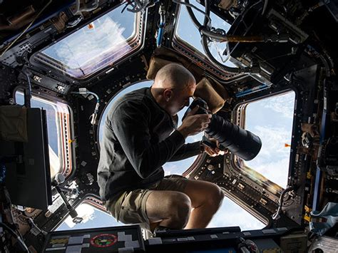 iss cupola photographing earth from the cupola on the international