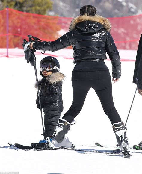 North West gets a ski lesson on the slopes from Kim ...