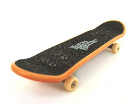 finger bored wood fingerboard deck vs plastics