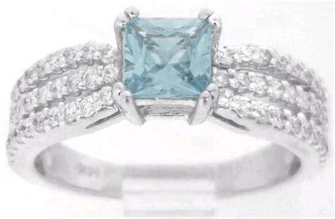 princess cut aquamarine  diamond engagement ring   row diamond band matching skinny
