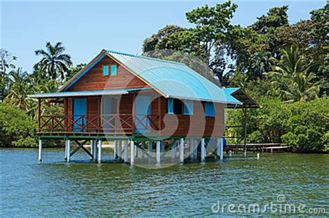 Bungalow On Stilts Over Water Of The Caribbean Sea Stock
