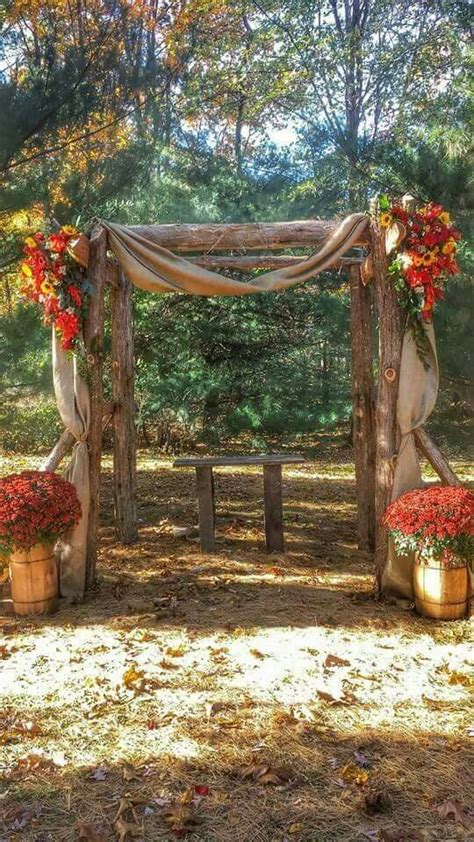 cedar arbor decorated  fall flowers  burlap