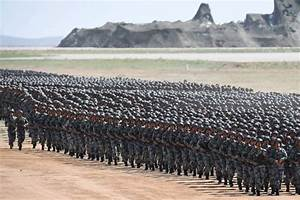 China parades MASSIVE military as war fear rise over North ...