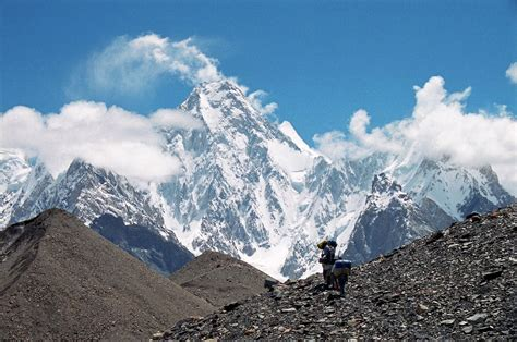 36 Porters Nearing Concordia With Gasherbrum Iv Towering