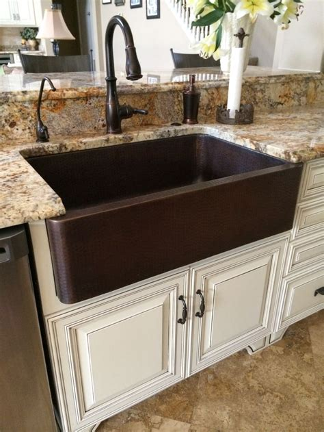 kitchen sinks for less hammered copper farm sink moen rubbed bronze touch 6072