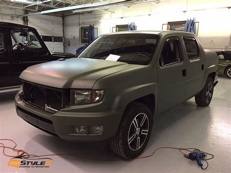matte military green honda ridgeline vehicle