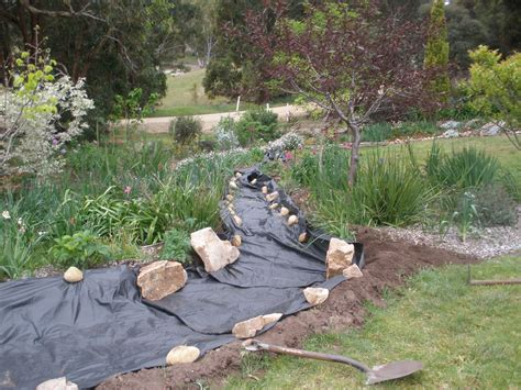 Garten Landschaftsbau Tarp by Creek Bed Laying Foundational Tarp Mesh Creek