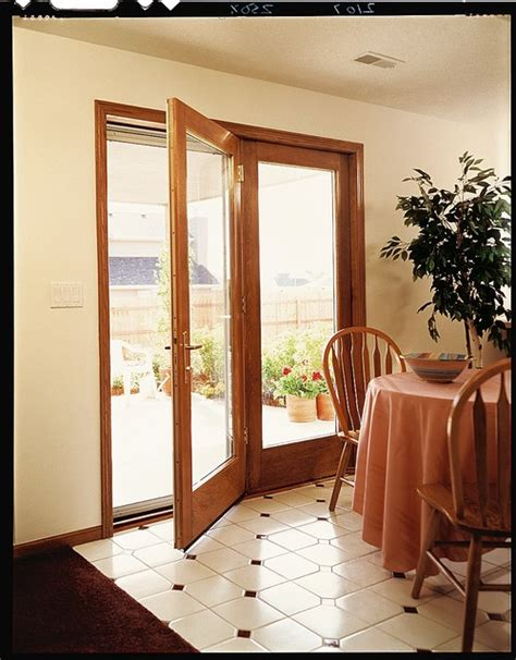 pella hinged patio doors andersen folding outswing patio