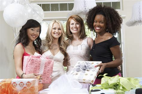 friends shower together friends standing together with gifts at bridal shower