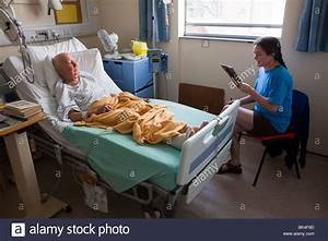 Patient in hospital bed with visitor Wales UK Stock Photo ...