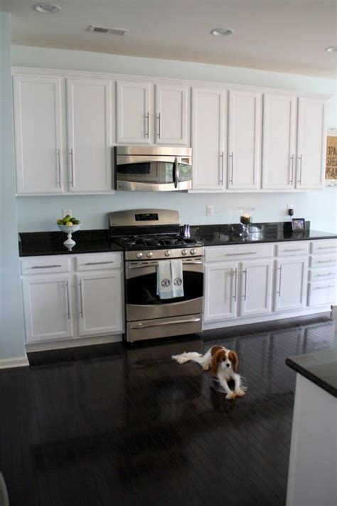 Kitchen Floors And Countertops by White Cabinets Floor Wall Color Sherwin Williams
