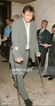 Liam Neeson, on crutches due to a bad motorcycle accident ...
