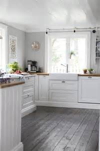 White Kitchen with Grey Wood Floors
