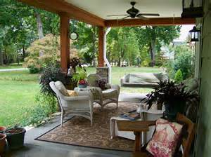 outdoor covered patios porch traditional with area rug