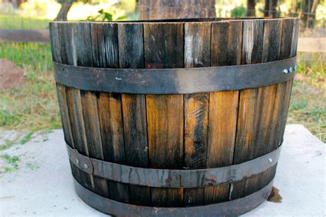 whiskey barrel planter the whiskey barrel planter 171 rust and ruffles